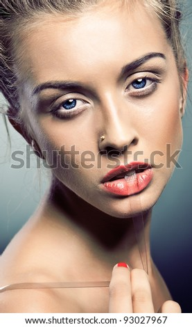 Portrait of beautiful woman on blue background - stock photo
