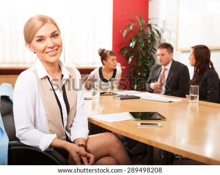 Portrait of beautiful woman on the background of business people - stock photo