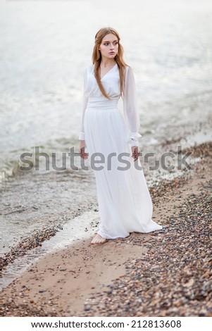 Portrait of beautiful woman on the beach - stock photo