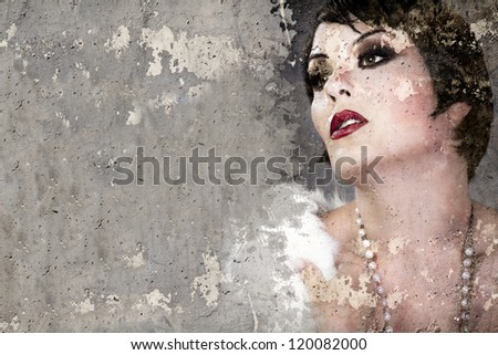 Portrait of beautiful woman over dirty wall