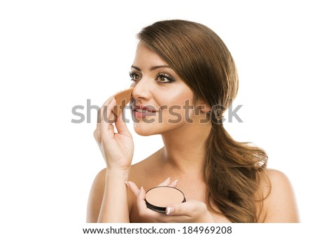 Portrait of beautiful woman putting make up on herself, isolated on white background - stock photo