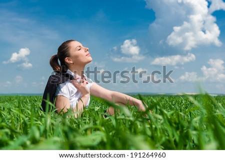 portrait of beautiful woman relaxing on field