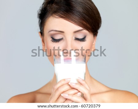Portrait of beautiful woman, she holdin glass of milk - stock photo