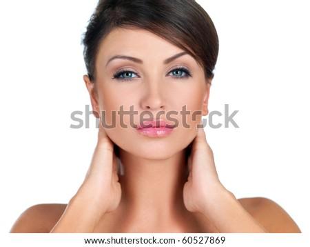 Portrait of beautiful woman she is doing neck massage - stock photo