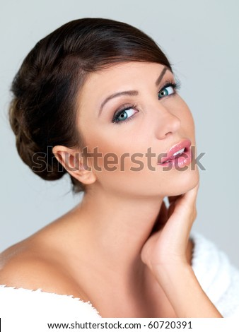 Portrait of beautiful woman, she is isolated on grey - stock photo