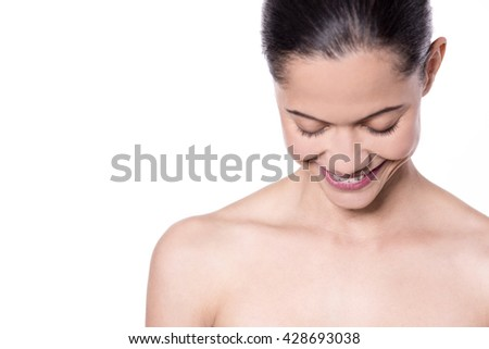 Portrait of beautiful woman, she is looking down. - stock photo