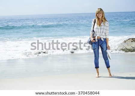 Portrait of beautiful woman standing on beach