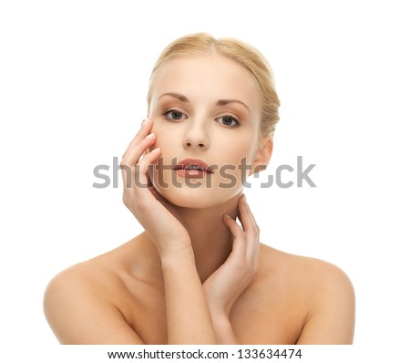 portrait of beautiful woman touching her face skin - stock photo