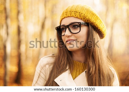 Portrait of beautiful woman wearing fashion glasses during the autumn  - stock photo