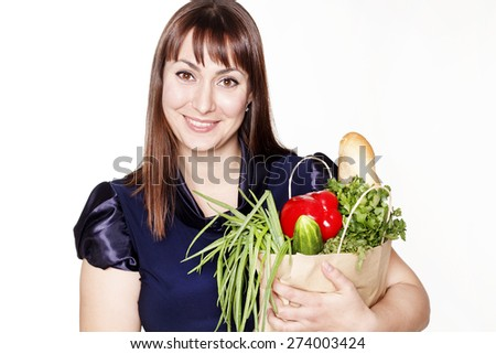 Portrait of beautiful woman with a bag of products over white background