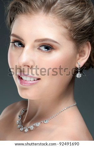 Portrait of beautiful woman with beautiful make-up and hairstyle. Elegant woman with diamond jewelry - stock photo