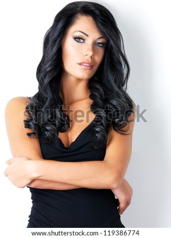 Portrait of beautiful woman with beauty long brown hair - posing at studio - stock photo