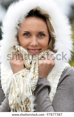 portrait of beautiful woman with blue eyes in autumn