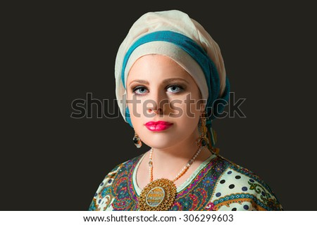 Portrait of beautiful  woman  with blue eyes with turban,studio shoot