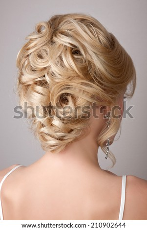 Portrait of beautiful woman with bridal hairstyle and jewelry - earrings, wedding style
