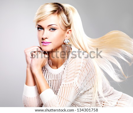 Portrait of beautiful woman with bright fashion makeup and long white hairs.