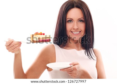 Portrait of beautiful woman with cake isolated over white background