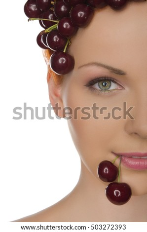 Portrait of beautiful woman with cherry isolated on white