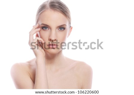Portrait of beautiful woman with clean face over white background - stock photo