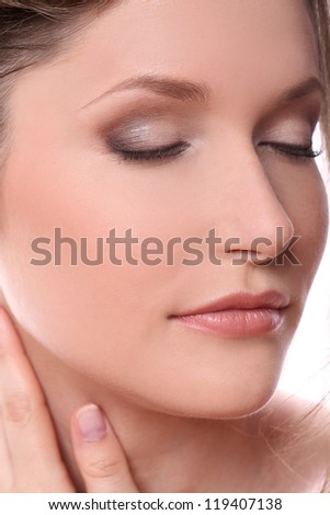 Portrait of beautiful woman with clean skin over a white background