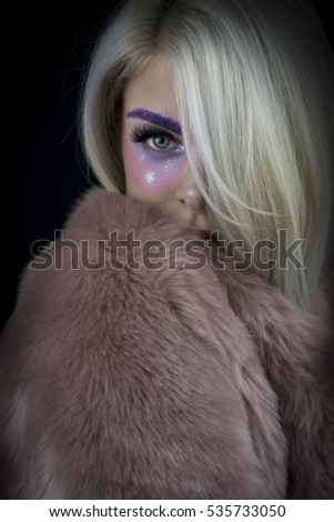 Portrait of beautiful woman with color make-up.