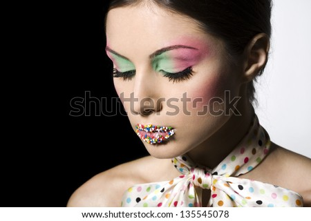 portrait of beautiful woman with colorful make-up - stock photo