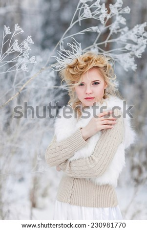 Portrait of beautiful woman with crown on her head - stock photo