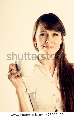 Portrait of beautiful woman with cup of coffee, instagram style filtered