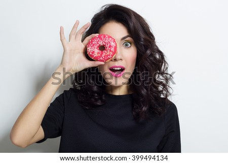 Portrait of beautiful woman with donut - stock photo