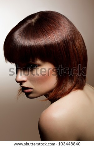 Portrait of beautiful  woman with elegant hairstyle - stock photo