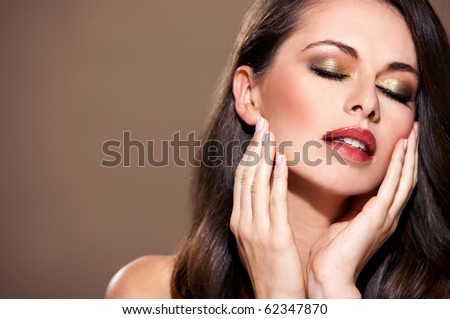 Portrait of beautiful woman with eyes closed isolated on beige