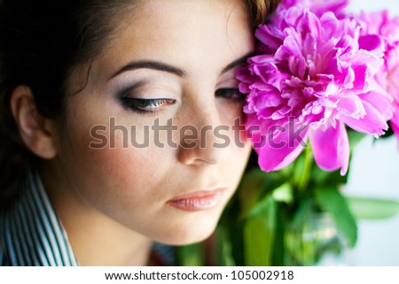 portrait of beautiful woman with flowers