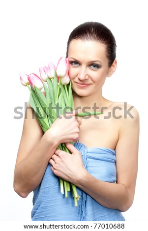 Portrait of beautiful woman with flowers on white background