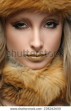 Portrait of beautiful woman with fur. - stock photo