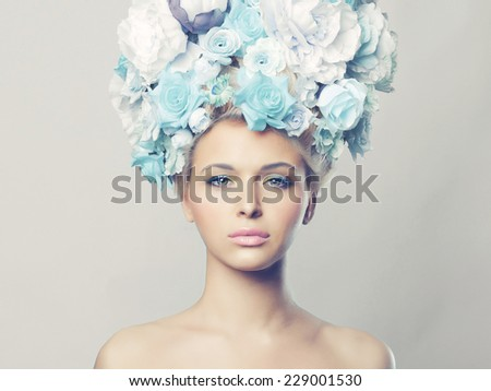 Portrait of beautiful woman with hairstyle of flowers. Fashion photo - stock photo