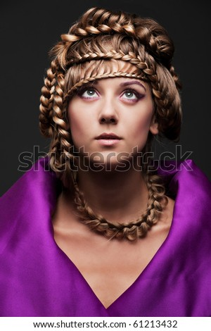 portrait of beautiful woman with hairstyle over dark background - stock photo