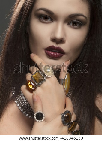 Portrait of beautiful woman with jewelry.  - stock photo