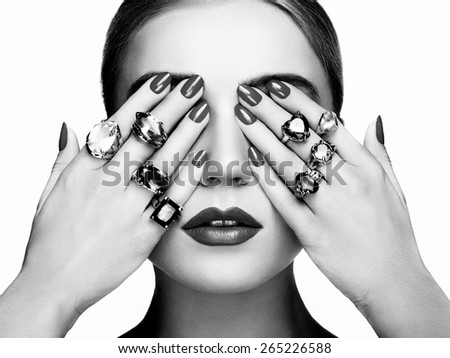 Portrait of beautiful woman with jewelry. Manicure and makeup. Perfect skin. Fashion beauty. Ring. Blonde girl. Close up. Black and white - stock photo