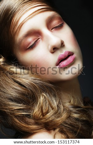 Portrait of beautiful  woman with long blond curly hair. Bridal hairstyle. - stock photo