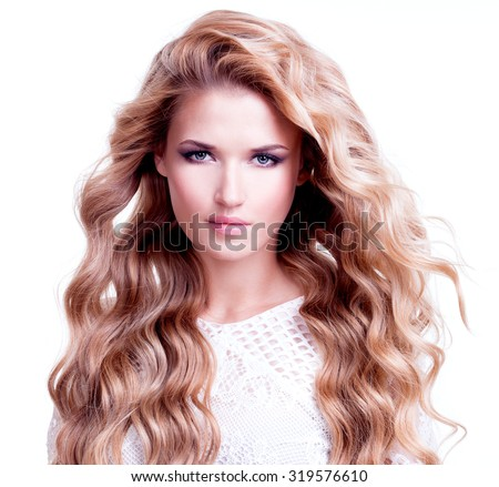 Portrait of beautiful woman with long blond curly hair. Fashion model posing on white background. - stock photo