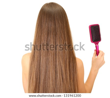 Portrait of beautiful woman with long hair and a hairbrush, isolated on white - stock photo