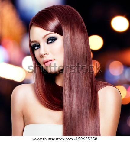 Portrait of beautiful woman with long straight hair - stock photo