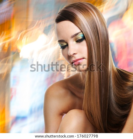 Portrait of beautiful woman with long straight hairs and fashion makeup of eyes - stock photo