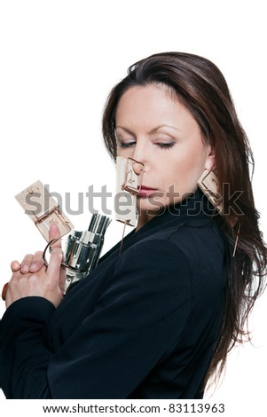 Portrait of beautiful woman with mousetraps holding revolver in studio isolated on white background - stock photo