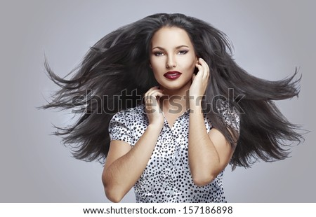 Portrait of beautiful woman with perfect make up and flyong hair - stock photo