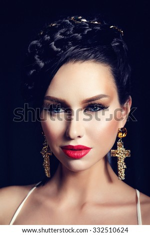 Portrait of Beautiful Woman with Perfect Makeup and Luxury Accessories. Close Up Isolated