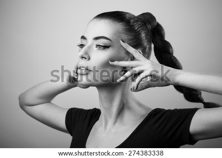 Portrait of beautiful woman with perfect skin and make-up. Black and white - stock photo