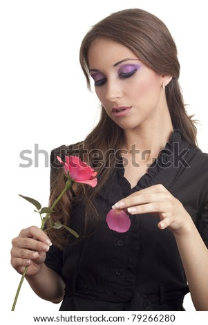 Portrait of beautiful woman with rose