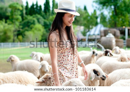 portrait of beautiful woman with sheep