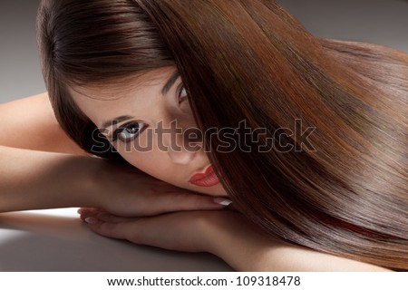 Portrait of Beautiful Woman with smooth gloss long hair - stock photo